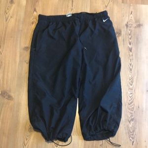 Nike tracking pants with two zippers pockets